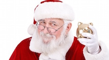 Santa Claus holding piggy bank